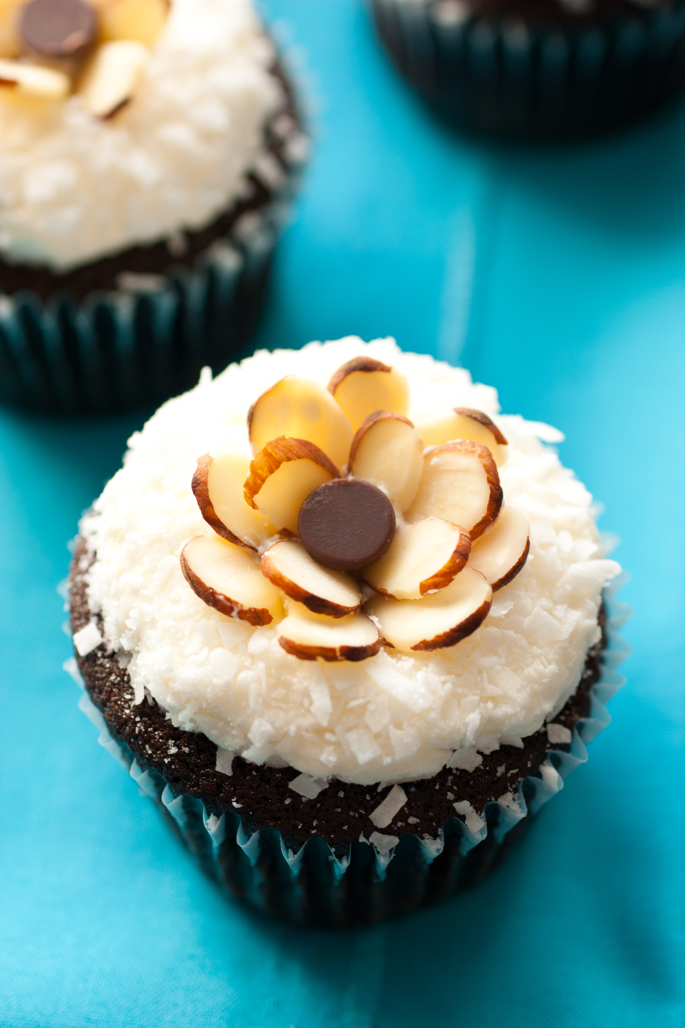 Chocolate Cupcakes with Coconut Frosting & Almonds